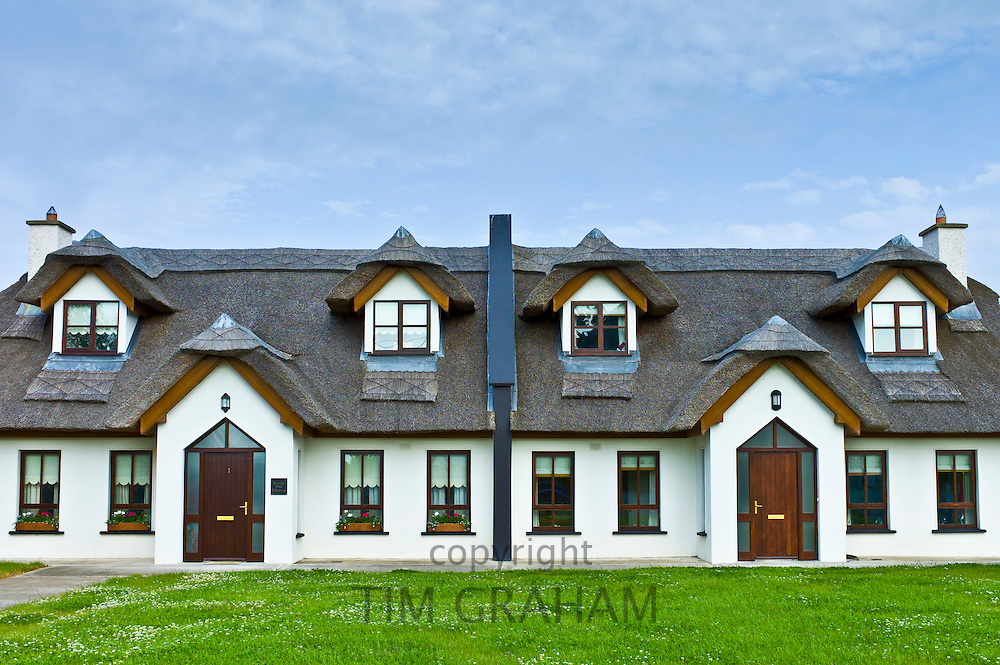 Repro thatched cottages in new development in County Wexford,  Ireland. EU funds led to 'Celtic tiger' investment in the Republic