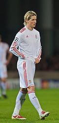 LYON, FRANCE - Wednesday, November 4, 2009: Liverpool's Fernando Torres 'adjusts' himself during the UEFA Champions League Group E match against Olympique Lyonnais at Stade Gerland. (Pic by David Rawcliffe/Propaganda)
