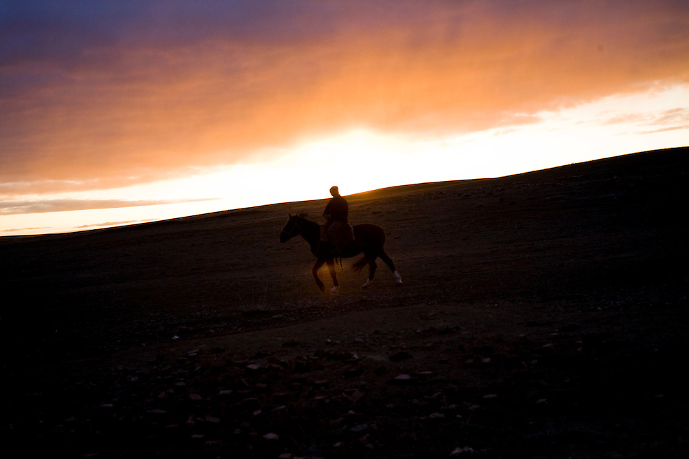 CREDIT: DOMINIC BRACCO II..SLUG:PRJ/KAZAKHSTAN SHEEP HERDERS..DATE:10/23/2009..CAPTION:Madina Manasbayeva rides out at sunset to herd up her sheep out on the steppe near Semey, Kazakhstan. The herders live near a radio active lake which was made during the 1970s as part of an experiment by the USSR to create lakes from atomic bombs. The lake is in an area known as The Polygon, a test site for more than 400 of the Soviet Union's nuclear weapons.