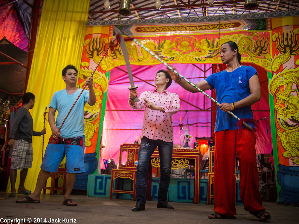 27 SEPTEMBER 2014 - BANGKOK, THAILAND: Performers in a Chinese opera rehearse a fight scene during the celebration of the Vegetarian Festival at the Chow Su Kong Shrine in Talat Noi, a Chinese enclave in Bangkok. The Vegetarian Festival is celebrated throughout Thailand. It is the Thai version of the The Nine Emperor Gods Festival, a nine-day Taoist celebration beginning on the eve of 9th lunar month of the Chinese calendar. During a period of nine days, those who are participating in the festival dress all in white and abstain from eating meat, poultry, seafood, and dairy products. Vendors and proprietors of restaurants indicate that vegetarian food is for sale by putting a yellow flag out with Thai characters for meatless written on it in red.    PHOTO BY JACK KURTZ