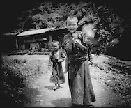 Surprised Tamang children on the road to Syabru, Langtang region, Nepal.