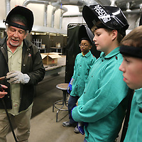 Ron Brady, welding instructor at ICC in Belden, goes over the proper use and handling of a MIG welder torch as he describes how the nozzle works to a group of area middle school students as they attend the welding portion of the ICC Advanced Manufacturing Camp on Wednesday afternoon.