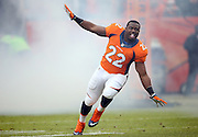 Denver Broncos running back C.J. Anderson (22) runs like an airplane as he comes onto the field in a cloud of smoke during pregame player introductions before the NFL week 19 AFC Divisional Playoff football game against the Indianapolis Colts on Sunday, Jan. 11, 2015 in Denver. The Colts won the game 24-13. ©Paul Anthony Spinelli