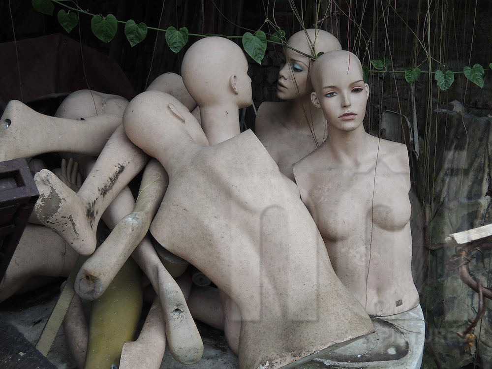 Pile of mannequin parts left in a yard, Hanoi, Vietnam, Southeast Asia