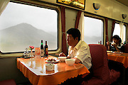 Chinese tourist in a restaurant on train