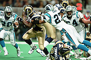 Defensive back Deon Grant (27) of the Carolina Panthers grabs on to Running Back Marshall Faulk (28) of the St. Louis Rams during a 48 to 14 win by the Rams on 11/11/2001..©Wesley Hitt/NFL Photos