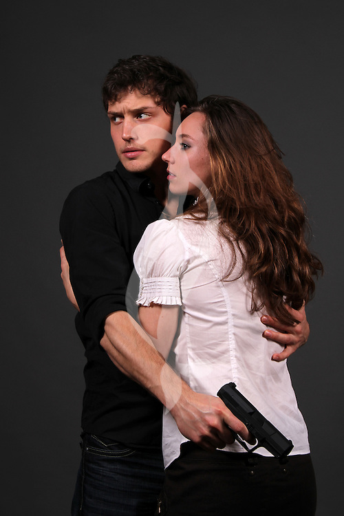 couple posing in contemporary outfits Romantic Suspense Couple Romantic Suspense Couple Romantic Suspense Couple
