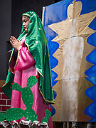 11 DECEMBER 2019 - DES MOINES, IOWA: A teenager playing Our Lady of Guadalupe during the Virgin of Guadalupe celebration at Our Lady of the Americas Catholic Church in Des Moines. Virgin of Guadalupe Day is one of the most important holy days in Mexican Catholicism. It marks Dec. 12, 1531, the day Juan Diego, an indigenous Mexican peasant, saw an apparition of the Virgin Mary on a barren hillside in what is now Mexico City. A basilica was built on the site. Virgin of Guadalupe Day is celebrated throughout Mexico and in Mexican communities in the United States.              PHOTO BY JACK KURTZ
