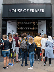 © Licensed to London News Pictures. 10/08/2018. London, UK. Shoppers wait outside House of Fraser's flagship store on Oxford Street in London after news that it had gone into administration. The department store chain has reportedly been bought by Sports Direct for £90m after administrators were appointed. Photo credit: Rob Pinney/LNP
