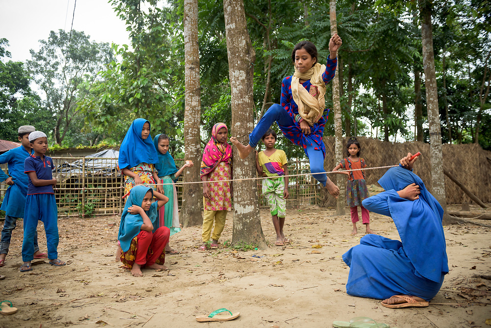Fermina Attar, age 10, a Rohingya Muslim who with her family recently fled government-sanctioned violence in Myanmar's Rakhine State, jumps over a rope at a Child Friendly Space in Shamlapur refugee camp near Cox's Bazar, Bangladesh.
