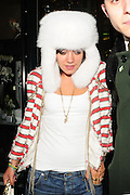 19.JAN.2009 - LONDON<br /> <br /> LILY ALLEN LEAVES THE IVY CLUB AT 11.30PM WEARING A FLUFFY WHITE RUSSAIN HAT AFTER HAVING DINNER WITH A MYSTERY MAN WHO SHE TOOK HOME WITH HER WHEN SHE GOT HOME HER EYES WERE ROLLING AND HER BUM WAS HANGING OUT HER JEANS.<br /> <br /> BYLINE MUST READ : EDBIMAGEARCHIVE.COM<br /> <br /> *THIS IMAGE IS STRICTLEY FOR UK NEWSPAPERS & MAGAZINES ONLY*<br /> *FOR WORLDWIDE SALES OR WEB USE PLEASE CONTACT EDBIMAGEARCHIVE - 0208 954 5968*