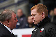 Steve Evans and Neil Lennon before the Sky Bet Championship match between Bolton Wanderers and Leeds United at the Macron Stadium, Bolton, England on 24 October 2015. Photo by Pete Burns.