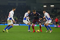 Football - 2018 / 2019 Premier League - Brighton and Hove Albion vs. Arsenal<br /> <br /> Aaron Ramsey of Arsenal finds himself surrounded by Solly March, Pascal Gross and Martin Montoya of Brighton at The Amex Stadium Brighton <br /> <br /> COLORSPORT/SHAUN BOGGUST