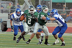 12 October 2013:  Devonte Jones finds a huge hole in the middle and gets a block from Brady Hails during an NCAA division 3 football game between the North Park vikings and the Illinois Wesleyan Titans in Tucci Stadium on Wilder Field, Bloomington IL