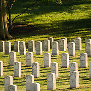 Rows of distinctive white headstones at the military cemetery of Arlington National Cemetery on the banks of the Potomac River across the Washington DC.