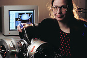 Virtual reality: Margaret Minsky works with a force-feedback joystick being developed in the MIT Media Laboratory. The joystick is designed to give its user a physical impression of features in a computer-generated environment. In this demonstration, the user is invited to feel shapes & textures whilst running a cursor over the various images displayed on the screen, and be able to differentiate between them. Model Released (1990)