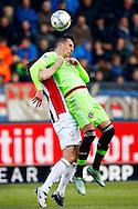 06-03-2016 VOETBAL:WILLEM II-AJAX:TILBURG <br /> Arek Milik van Ajax in duel met Freek Heerkens van Willem II <br /> <br /> Foto: Geert van Erven