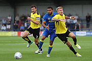 AFC Wimbledon striker Andy Barcham (17) being fouled during the Pre-Season Friendly match between AFC Wimbledon and Burton Albion at the Cherry Red Records Stadium, Kingston, England on 21 July 2017. Photo by Matthew Redman.