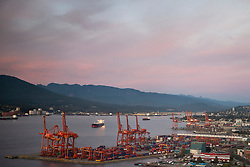 Port of Vancouver at dusk, with shipping terminals, Vancouver, British Columbia, Canada