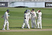 Simon Kerrigan celebrates bowling Stuart Broad with his team mates during the Specsavers County Champ Div 1 match between Lancashire County Cricket Club and Nottinghamshire County Cricket Club at the Emirates, Old Trafford, Manchester, United Kingdom on 17 April 2016. Photo by Simon Trafford.