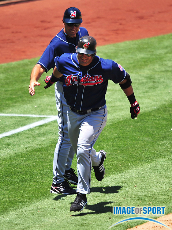 Jul 23, 2008; Anaheim, CA, USA; Cleveland Indians first baseman Ryan Garko (25) is congratulated by third base coach Joel Skinner (35) after hitting a two-run home run in the fourth inning against the Los Angeles Angels at Angel Stadium. The Angels defeated the Indians 14-11. Mandatory Credit: Kirby Lee/Image of Sport-US PRESSWIRE