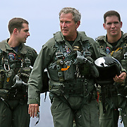 President Bush, wearing his flight suit, walks on the flight deck of the aircraft carrier USS Abraham Lincoln after arriving via a US Navy S-3B Viking Thursday, May 1, 2003, in the Pacific Ocean.  Bush traveled to the aircraft carrier USS Abraham Lincoln to meet with returning sailors and to announce and end to 'major combat operations' in Iraq...Photo by Khue Bui