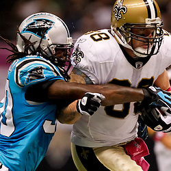 October 3, 2010; New Orleans, LA, USA; New Orleans Saints tight end Jeremy Shockey (88) is tackled by Carolina Panthers safety Charles Godfrey (30) during the second quarter at the Louisiana Superdome. Mandatory Credit: Derick E. Hingle