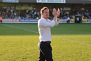AFC Wimbledon manager Neal Ardley clapping during the EFL Sky Bet League 1 match between AFC Wimbledon and Bury at the Cherry Red Records Stadium, Kingston, England on 5 May 2018. Picture by Matthew Redman.