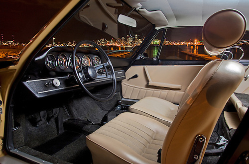 Image Of A Tan Sports Car Interior And The Seattle Skyline In Seattle,  Washington,