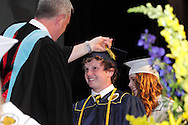 Principal Paul J. Waller (left) turns students tassels as they cross the stage during the Oakwood High School 88th annual commencement at the Dayton Convention Center in downtown Dayton, Monday, June 4, 2012.