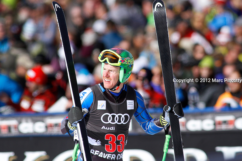 SHOT 11/30/12 1:22:52 PM - U.S. skier Ted Ligety checks the replay of his run after finishing the Birds of Prey Men's Downhill at Beaver Creek Ski Resort in Beaver Creek, Co. on Friday November 30, 2012. (Photo by Marc Piscotty / © 2012)