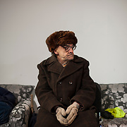 An anti-government protestor takes a rest at the occupied Ukraine House in central Kiev, hours after violent confrontations with a group of riot police taken refuge inside the building.
