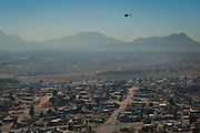Mexican Army helicopter patrols the slums of Anarba, one of the poorest slums of Juarez, where a ready supply of gang members fuel the ongoing drug war in  Mexico January 15, 2009. The drug war has already claimed more than 40 people since the start of the year. More than 1600 people were killed in Juarez in 2008, making Juarez the most violent city in Mexico.    (Photo by Richard Ellis)