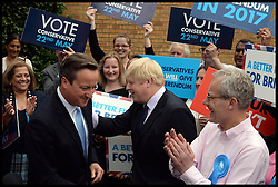 David Cameron and Boris Johnson campaigning in the car park at the Conservative Association HQ in Ealing West London, United Kingdom. Wednesday, 21st May 2014. Picture by Andrew Parsons / i-Images