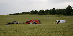 © licensed to London News Pictures. Andover, UK  05/07/11. The fire brigade attend the scene. A British RAF Puma helicopter pilot and two crew members escaped without serious injury today after crash-landing in a field. Police said the crewmen were able to walk away unharmed after the Puma helicopter came down close to the A303, near the Walworth industrial estate in Andover, Hampshire.. Photo credit should read Ian Forsyth/LNP