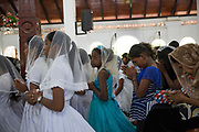 Members of the Afro-Sri Lankan community gather at St Mary's Church on the event of the 500 year celebration held on September 24th. The date of the event was decided by them and roughly relates to the time they believe the first African slaves were brought to the Island by the Portuguese at the beginning of the 16th Century. It began with Sunday Mass at the Church.<br /> <br /> Out of all communities of African diaspora that surround the Indian Ocean those of Sri Lanka are by far the smallest and most fragile, first brought by the Portuguese, the Dutch and eventually the British as slaves.<br /> <br /> After the Abolition of the Slave Trade Act was passed in the British Parliament in 1807, the process of putting an end to slavery began in British controlled countries. On being emancipated most Africans stayed and a century ago the Afro-Sri Lankan population was believed to be around 6000 people. Today that number has dwindled to less than 500 and are likely to totally disappear in a few generations.