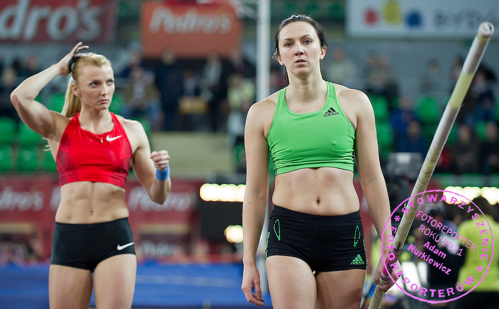 (L) Anna Rogowska of Poland and (R) Monika Pyrek of Poland compete in women's pole vault during indoor athletics meeting Pedro's Cup 2012 at Luczniczka Hall in Bydgoszcz, Poland.<br /> <br /> Poland, Bydgoszcz, February 8, 2012.<br /> <br /> Picture also available in RAW (NEF) or TIFF format on special request.<br /> <br /> For editorial use only. Any commercial or promotional use requires permission.<br /> <br /> Mandatory credit:<br /> Photo by &copy; Adam Nurkiewicz / Mediasport