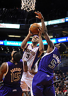 Dec. 17, 2012; Phoenix, AZ, USA; Phoenix Suns forward Jared Dudley (3) puts up the ball during the game against the Sacramento Kings center DeMarcus Cousins (15) and guard John Salmons (5) in the second half at US Airways Center. The Suns defeated the Kings 101-90.  Mandatory Credit: Jennifer Stewart-USA TODAY Sports