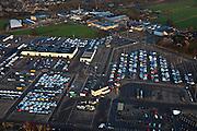 Nederland, Provincie, Leusden, 10-01-2011;.Parkeerterrein en gebouwen van PON automobielbedrijf bedrijven, importeur vano.a.  Volkswagen (VW), Audi, Seat, Skoda, Porsche. Het parkeerterrein is niet helemaal gevuld, nieuwe autoverkoop is teruggelopen door de financiele crisis...luchtfoto (toeslag), aerial photo (additional fee required).foto/photo Siebe Swart