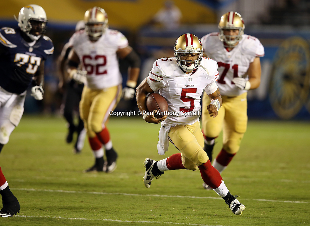San Francisco 49ers quarterback B.J. Daniels (5) runs for a gain of 36 yards and a first down in the fourth quarter during the NFL week 4 preseason football game against the San Diego Chargers on Thursday, Aug. 29, 2013 in San Diego. The 49ers won the game 41-6. ©Paul Anthony Spinelli