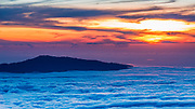 Hualalai Volcano from the summit of Mauna Kea at sunset, The Big Island, Hawaii USA