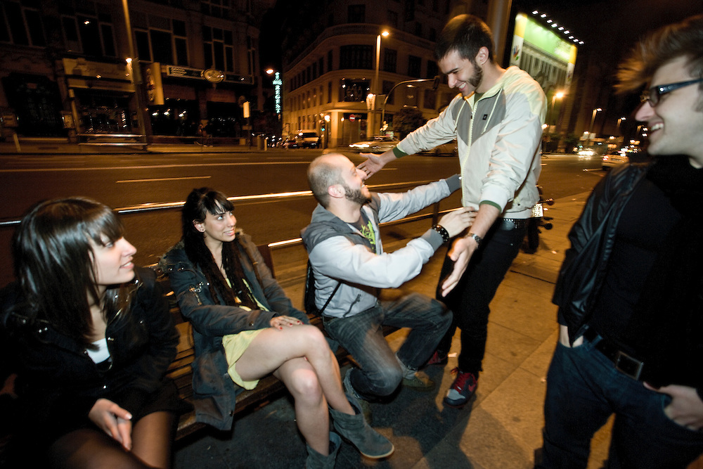 4:11 AM: Marco Fiordalisi, 26,meets his group of friends during a party night in Madrid..