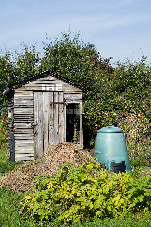 A shed and composter in an allotment site in Harrow London