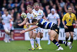 Sam Hill of Exeter Chiefs offloads the ball after being tackled by Sam Burgess of Bath Rugby - Mandatory byline: Patrick Khachfe/JMP - 07966 386802 - 17/10/2015 - RUGBY UNION - The Recreation Ground - Bath, England - Bath Rugby v Exeter Chiefs - Aviva Premiership.