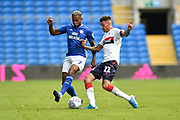 Leandro Bacuna (7) of Cardiff City battles for possession with Marvin Johnson (21) of Middlesbrough during the EFL Sky Bet Championship match between Cardiff City and Middlesbrough at the Cardiff City Stadium, Cardiff, Wales on 21 September 2019.