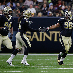 Aug 26, 2017; New Orleans, LA, USA; New Orleans Saints defensive end Cameron Jordan (94) and linebacker Hau'oli Kikaha (44) and defensive tackle Sheldon Rankins (98) during the first half of a preseason game at the Mercedes-Benz Superdome. Mandatory Credit: Derick E. Hingle-USA TODAY Sports