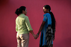 American Jessica Ordenes, 40, and her surrogate Najima Vohra, 30 hold hands together in Anand, India on April 12, 2007.  Najima, a first time surrogate, wants to pay for her two children's education with the money she will make from this pregnancy. Dr. Nayna Patel, the hospital director, currently has more than 25 women who have been implanted with embryos at her clinic. A few have already gone through the process once and are eager for a second go-round. While Patel claims many of the women do this for altruistic reasons, she acknowledges that money was the primary reason these women had queued up to be surrogates; without it, the list would be short, if not nonexistent. Payment usually ranges from about $2,800 to $5,600, a fortune in a country where annual per capita income hovers around $500.
