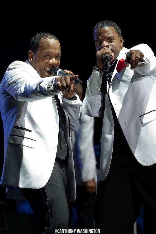 Michael Bivens and Ricky Bell of the group New Edition point towards a fan during the groups 30th Anniversary Reunion Tour at the 1st Mariner Arena in Baltimore, MD on Sunday, May 20, 2012.