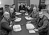 All party crisis conference at Stormont Castle following Loyalist strike and alleged intimidation culminating in Loyalist crowds attacking Willowfield and Donegall Pass police stations. L to R around the table - Phelim O'Neill, Ulster Unionist, Brian Faulkner, leader, Ulster Unionist Party, David Howell, Minister of State, NIO,  William Whitelaw; Secretary of State for N Ireland, Sir William Nield, permanent secretary, NIO, Vivian Simpson; N Ireland Labour Party; Rev Ian Paisley, Democratic Unionist Party. 197302090087c.<br /> <br /> Copyright Image from Victor Patterson, 54 Dorchester Park, <br /> Belfast, UK, BT9 6RJ<br /> <br /> t1: +44 28 9066 1296 (from Rep of Ireland 048 9066 1296)<br /> t2: +44 28 9002 2446 (from Rep of Ireland 048 9002 2446)<br /> m: +44 7802 353836<br /> <br /> e1: victorpatterson@me.com<br /> e2: victorpatterson@gmail.com<br /> www.victorpatterson.com<br /> <br /> Please see my Terms and Conditions of Use at www.victorpatterson.com. It is IMPORTANT that you familiarise yourself with them.<br /> <br /> Images used on the Internet must be visibly watermarked i.e. © Victor Patterson<br /> within the body of the image and copyright metadata must not be deleted. Images <br /> used on the Internet have a size restriction of 4kbs and will be chargeable at current<br />  NUJ rates unless agreed otherwise.<br /> <br /> This image is only available for the use of the download recipient i.e. television station, newspaper, magazine, book publisher, etc, and must not be passed on to any third <br /> party. It is also downloaded on condition that each and every usage is notified within 7 days to victorpatterson@me.com<br /> <br /> The right of Victor Patterson to be identified as the author is asserted in accordance with The Copyright Designs And Patents Act (1988). All moral rights are asserted.