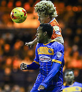 Scott Griffiths of Luton Town (rear) and Cameron Gayle of Shrewsbury Town in an aerial battle during the Sky Bet League 2 match at Kenilworth Road, Luton<br /> Picture by David Horn/Focus Images Ltd +44 7545 970036<br /> 08/01/2015
